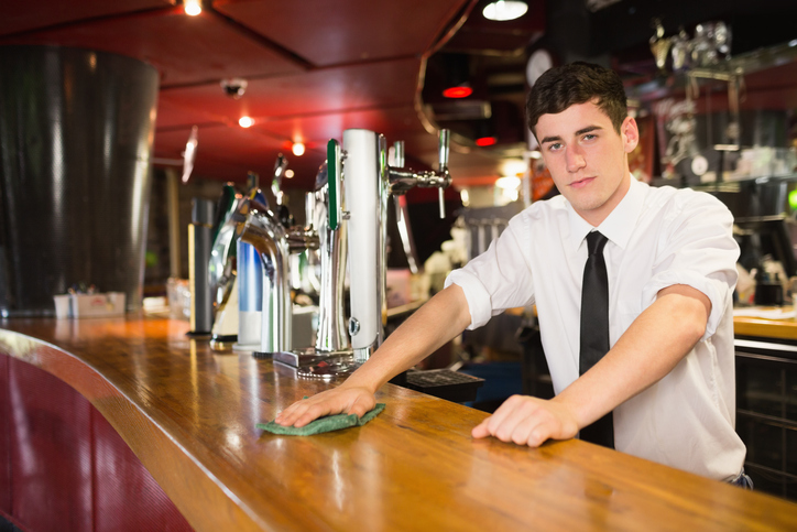 Bartender wiping bar
