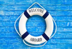flotation device says welcome aboard to new boat owners