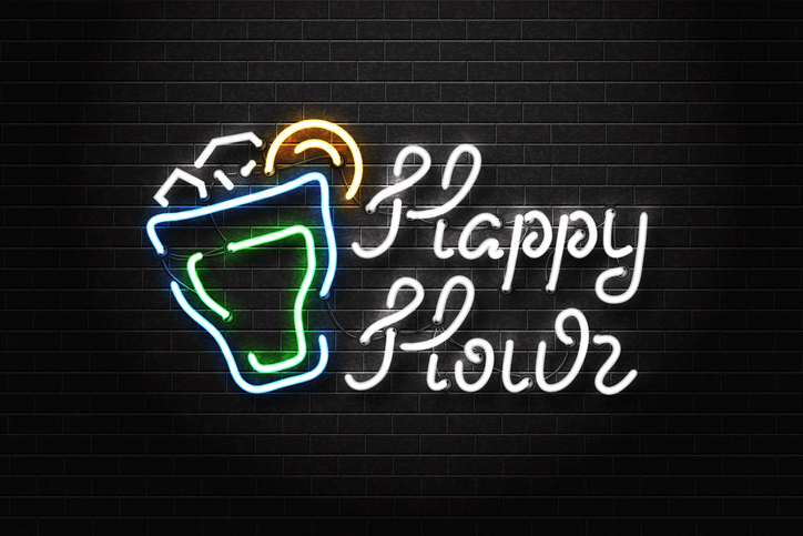 happy hour sign outside of bar or restaurant