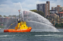 firefighting tug getting ready to put out a boat fire