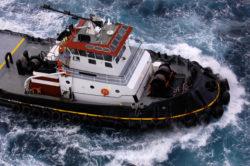 Tugboat in stormy seas