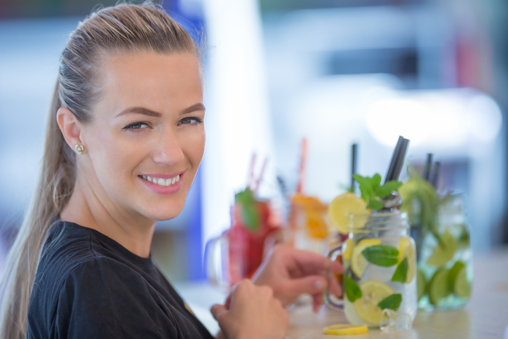 attract young bar owner preparing drinks as part of good customer service