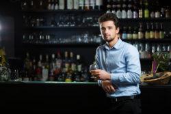 Young businessman at bar counter