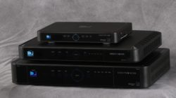 DIRECTV receivers stacked on top of one another