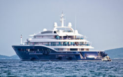 Anonymus luxury mega yacht on open sea, side view