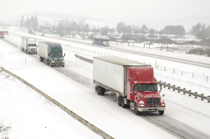 Semi Trucks Driving on Freeway Snow