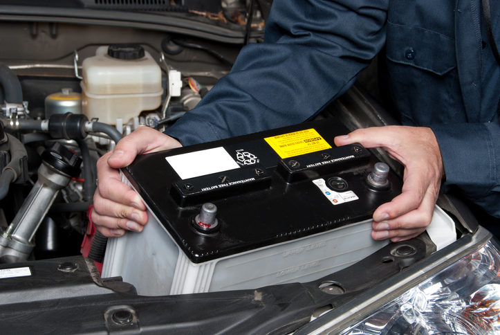 Auto mechanic replacing RV battery