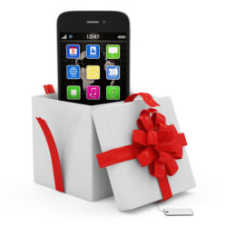 Opened Gift Box with Touchscreen Smartphone isolated on white background