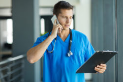 professional medical doctor talking on mobile phone in hospital