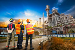 Engineer team in uniform are safety survey of the oil refiner industry